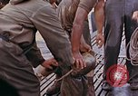 Image of US submarine rescues survivors from Japanese boat Pacific Ocean, 1945, second 28 stock footage video 65675052640