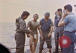 Image of US submarine rescues survivors from Japanese boat Pacific Ocean, 1945, second 30 stock footage video 65675052640