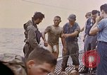 Image of US submarine rescues survivors from Japanese boat Pacific Ocean, 1945, second 31 stock footage video 65675052640