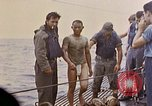Image of US submarine rescues survivors from Japanese boat Pacific Ocean, 1945, second 32 stock footage video 65675052640