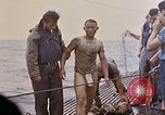 Image of US submarine rescues survivors from Japanese boat Pacific Ocean, 1945, second 33 stock footage video 65675052640