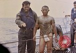 Image of US submarine rescues survivors from Japanese boat Pacific Ocean, 1945, second 34 stock footage video 65675052640