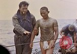 Image of US submarine rescues survivors from Japanese boat Pacific Ocean, 1945, second 35 stock footage video 65675052640
