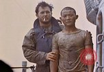 Image of US submarine rescues survivors from Japanese boat Pacific Ocean, 1945, second 37 stock footage video 65675052640