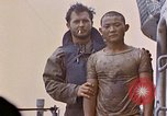 Image of US submarine rescues survivors from Japanese boat Pacific Ocean, 1945, second 38 stock footage video 65675052640