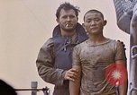 Image of US submarine rescues survivors from Japanese boat Pacific Ocean, 1945, second 39 stock footage video 65675052640