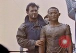 Image of US submarine rescues survivors from Japanese boat Pacific Ocean, 1945, second 41 stock footage video 65675052640