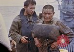 Image of US submarine rescues survivors from Japanese boat Pacific Ocean, 1945, second 62 stock footage video 65675052640