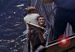 Image of US submarine firing 5 inch guns at targets in Japanese waters Japan, 1945, second 27 stock footage video 65675052641