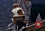 Image of US submarine firing 5 inch guns at targets in Japanese waters Japan, 1945, second 28 stock footage video 65675052641