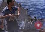 Image of US submarine firing 5 inch guns at targets in Japanese waters Japan, 1945, second 29 stock footage video 65675052641