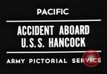 Image of USS Hancock on fire Pacific Ocean, 1945, second 1 stock footage video 65675052932