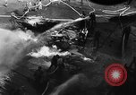 Image of USS Hancock on fire Pacific Ocean, 1945, second 23 stock footage video 65675052932