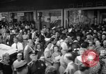 Image of women buying silk stockings during war ration United States USA, 1942, second 12 stock footage video 65675053064