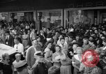 Image of women buying silk stockings during war ration United States USA, 1942, second 13 stock footage video 65675053064