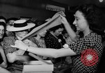 Image of women buying silk stockings during war ration United States USA, 1942, second 27 stock footage video 65675053064