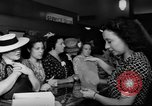 Image of women buying silk stockings during war ration United States USA, 1942, second 31 stock footage video 65675053064