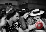 Image of women buying silk stockings during war ration United States USA, 1942, second 34 stock footage video 65675053064