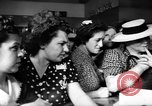 Image of women buying silk stockings during war ration United States USA, 1942, second 35 stock footage video 65675053064