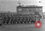 Image of military parade in town Russia, 1916, second 1 stock footage video 65675053078