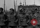 Image of military parade in town Russia, 1916, second 11 stock footage video 65675053078