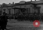 Image of military parade in town Russia, 1916, second 21 stock footage video 65675053078