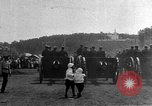 Image of military parade in town Russia, 1916, second 41 stock footage video 65675053078