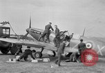 Image of Spitfire airplanes readied for combat United Kingdom, 1940, second 18 stock footage video 65675053155