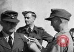 Image of German soldiers demobilized after surrender Germany, 1945, second 32 stock footage video 65675053400