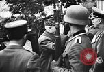 Image of Adolf Hitler shaking hands with Petain in Montoire France, 1940, second 17 stock footage video 65675053449