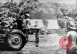Image of Troops load supplies on Higgins Boats Solomon Islands, 1944, second 25 stock footage video 65675053483