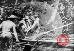 Image of Troops load supplies on Higgins Boats Solomon Islands, 1944, second 30 stock footage video 65675053483