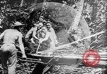 Image of Troops load supplies on Higgins Boats Solomon Islands, 1944, second 31 stock footage video 65675053483
