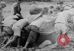 Image of Troops load supplies on Higgins Boats Solomon Islands, 1944, second 34 stock footage video 65675053483