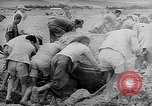 Image of Troops load supplies on Higgins Boats Solomon Islands, 1944, second 35 stock footage video 65675053483