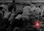Image of Troops load supplies on Higgins Boats Solomon Islands, 1944, second 36 stock footage video 65675053483