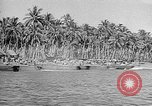 Image of Troops load supplies on Higgins Boats Solomon Islands, 1944, second 38 stock footage video 65675053483