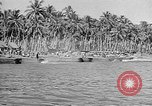 Image of Troops load supplies on Higgins Boats Solomon Islands, 1944, second 39 stock footage video 65675053483