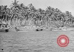 Image of Troops load supplies on Higgins Boats Solomon Islands, 1944, second 40 stock footage video 65675053483