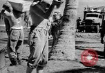 Image of Troops load supplies on Higgins Boats Solomon Islands, 1944, second 45 stock footage video 65675053483