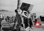 Image of Troops load supplies on Higgins Boats Solomon Islands, 1944, second 46 stock footage video 65675053483