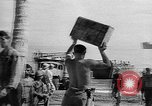 Image of Troops load supplies on Higgins Boats Solomon Islands, 1944, second 47 stock footage video 65675053483