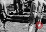 Image of Troops load supplies on Higgins Boats Solomon Islands, 1944, second 53 stock footage video 65675053483
