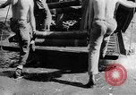Image of Troops load supplies on Higgins Boats Solomon Islands, 1944, second 54 stock footage video 65675053483