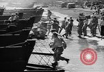 Image of Troops load supplies on Higgins Boats Solomon Islands, 1944, second 55 stock footage video 65675053483