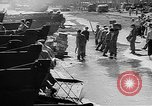 Image of Troops load supplies on Higgins Boats Solomon Islands, 1944, second 56 stock footage video 65675053483