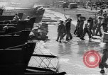 Image of Troops load supplies on Higgins Boats Solomon Islands, 1944, second 57 stock footage video 65675053483