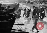 Image of Troops load supplies on Higgins Boats Solomon Islands, 1944, second 58 stock footage video 65675053483