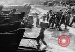 Image of Troops load supplies on Higgins Boats Solomon Islands, 1944, second 59 stock footage video 65675053483