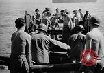 Image of Troops load supplies on Higgins Boats Solomon Islands, 1944, second 60 stock footage video 65675053483